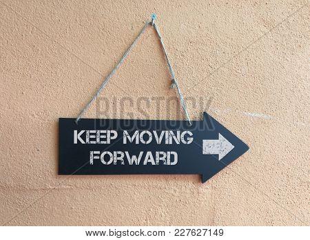 Keep moving forward signpost