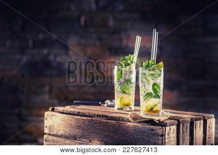 Mojito. Alcoholic Cocktail Drink Mojito On Wooden Board In Pub Or Sestaurant