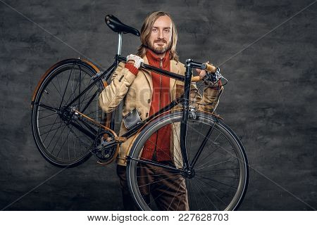 Casual Bearded Hipster Male Holds With Single Speed Bicycle Over Grey Background.