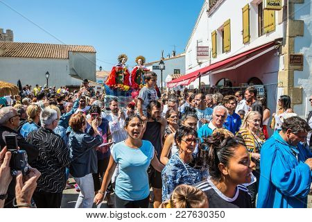 Saintes-Maries-de-la-Mer, France - May 25, 2015.  The concept of ethnographic tourism. Christians accompany two statues of the Holy Maries. Religious feast in honor of the Holy Maries in Provence