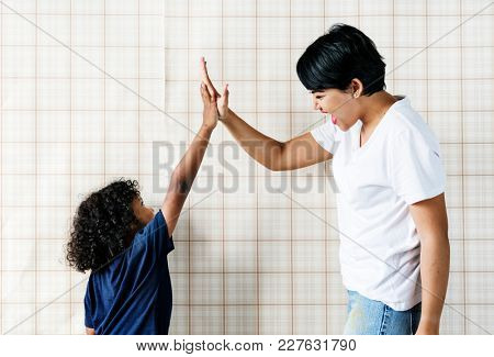 Young boy helping mom