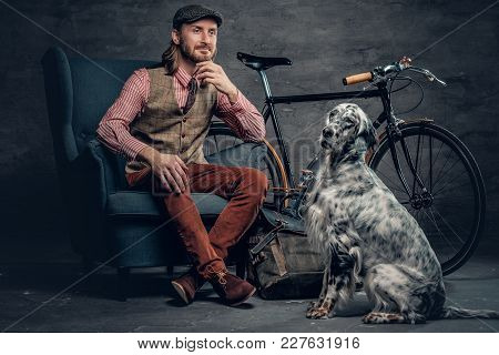 Stylish Male With Long Hair Posing With Ireland Setter And Single Speed Bicycle.
