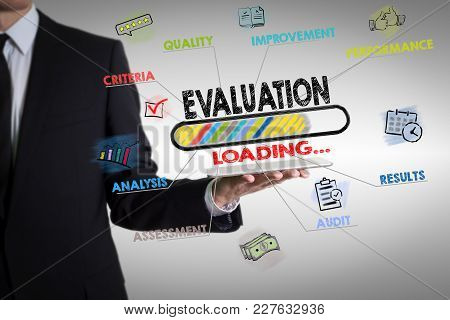 Evaluation Concept. Chart With Keywords And Icons. Man Holding A Tablet Computer