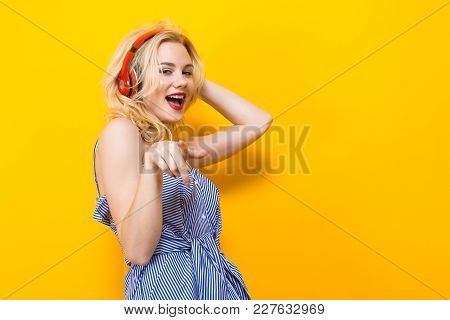 Blonde Cheerful Woman Dj With Red Lips In Blue Striped Shirt On Yellow Background With Copyspace Lis