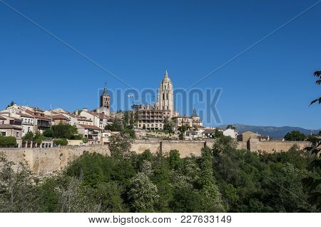 Views Of The City Of Segovia, Spain, From The City Wall, With The Cathedral And The Church Of Saint