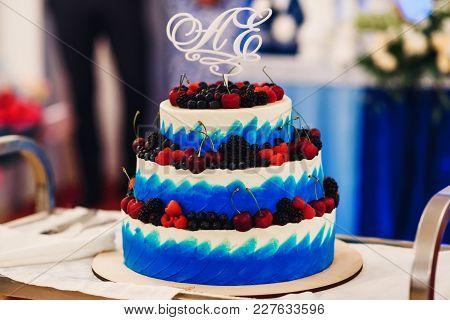 Wedding Cake In White Blue Glaze With Fresh Sweet Berries Cherries, Blueberries, Blackberries, Raspb