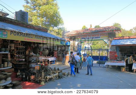 Pokhara Nepal - November 8, 2017: Unidentified People Visit Souvenir Shop At Devis Fall Waterfall In