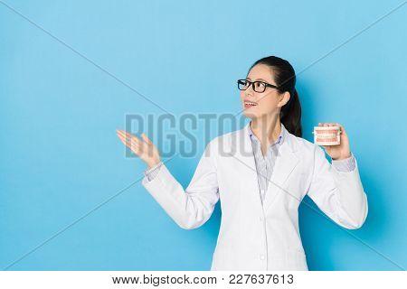 Female Hospital Doctor Showing Dental Teeth Mold