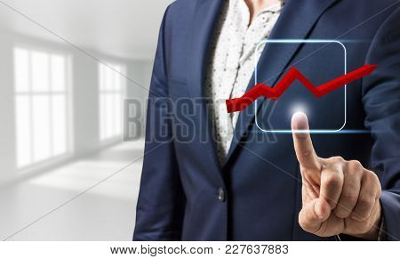 Businessman Hand Touching Virtual Graphic Icon With Arrow Over Dark Blue Background. 3d Rendering