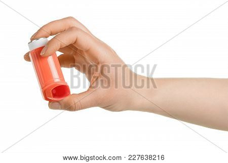 Portable Inhaler In Female Hand Isolated On White Background