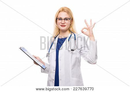 Female Doctor In White Coat And Glasses Wear Stethoscope And Hold Clip Pad With Medical Record Show