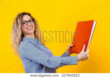 Portrait Of Attractive Happy Businesswoman In Striped Shirt And Eyeglasses Isolated On Orange Backgr