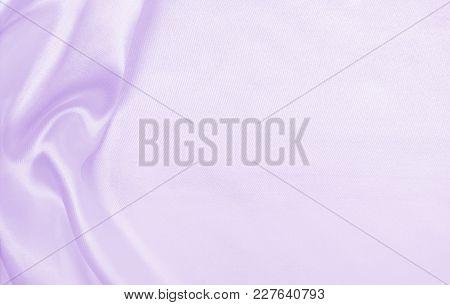 Smooth Elegant Lilac Silk Or Satin Texture As Wedding Background. Luxurious Background Design