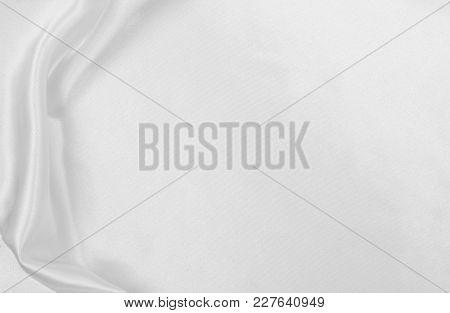 Smooth Elegant White Silk Or Satin Luxury Cloth Texture As Wedding Background. Luxurious Christmas B