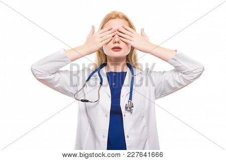 Female Doctor In White Coat Wearing Stethoscope Covering Her Eyes With Hands Isolated On White Backg