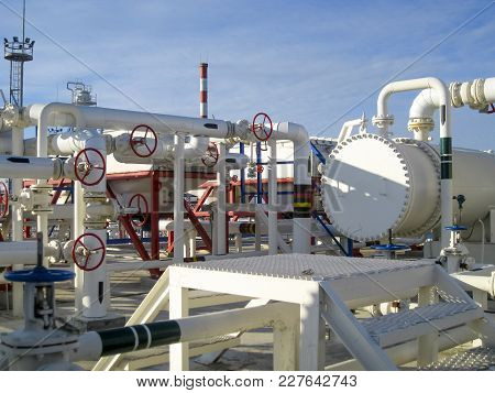 Heat Exchangers In A Refinery. The Equipment For Oil Refining. Heated Gasoline Air Cooler