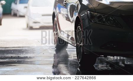 Washing A Car In The Suds By Water Hoses, Silhouette, Telephoto