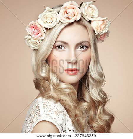Beautiful Blonde Woman With Flower Wreath On Her Head. Beauty Girl With Flowers Hairstyle. Perfect M