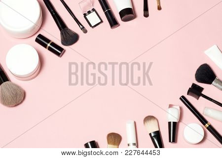 Concept Of A Cosmetic Tubes And Cream Containers Top View On Pink Background. Lipstick, Eyeliner, Br