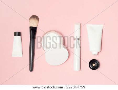 Concept Of A White And Black Cosmetic Supplies Top View On Pink Background