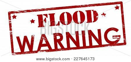 Rubber Stamp With Text Flood Warning Inside, Vector Illustration