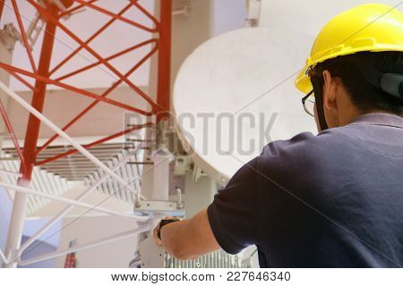 Asian Engineering Foreman Working On Indoor Antenna With Safety Accessories