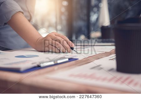 Hand Business People Pointing Paper Chart And Analysis Finance Earning Company At Room Office.