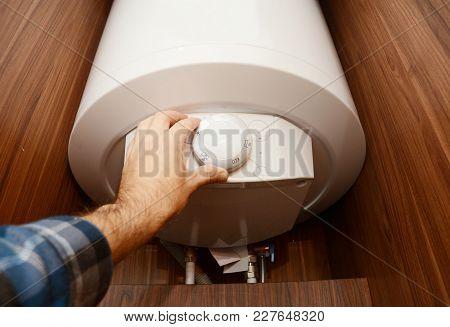 Man Hand Regulate Heat In Condensing Boiler, Combi Boiler For House Energy Saving. Gas Boiler, Boile