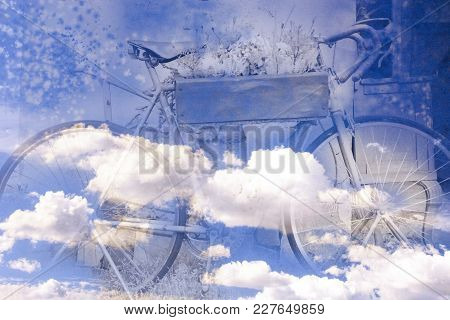 A Two-wheeled Bicycle On A Blue Background Is In The Clouds