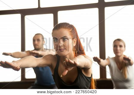 Sporty Beautiful Redhead Girl Doing Fitness Squat Exercise At Group Training, Fit Motivated Slim You