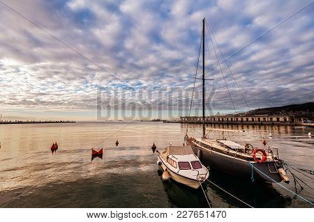 Pleasure Boats Moor  In Harbor At Sunset