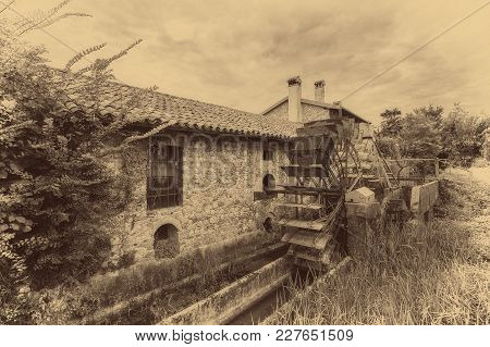 Old Water Wheels Of A Watermill. Vintage Style Picture.