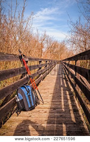Wooden Footbridge For Hiking In Nature With Backpack And Poles.