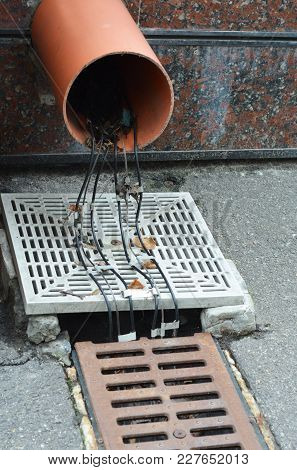 Gutter Deicing System. Gutter Heating. Close Up On Gutter Downspout Drainage Pipeline Deicing Cable