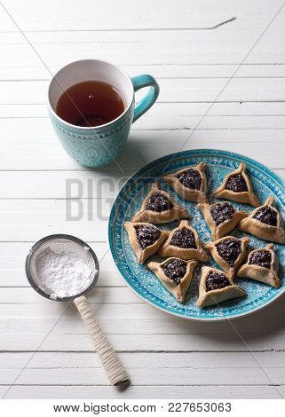 Traditional Sweets For The Jewish Holiday Purim. Hamantashen Cookies Or Ears Of Haman, Triangular Co
