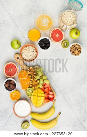 Healthy Breakfast, Oats, Fruits, Strawberries, Mango, Grapes, Figs And Dates, Yogurt And Nuts Served