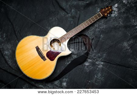 Acoustic Guitar In A Case On Dark Background Top