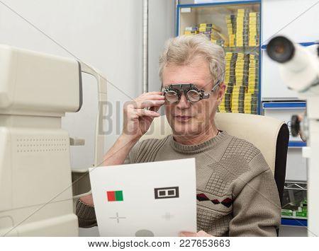 A Mature Man Checks Eyesight In An Ophthalmic Clinic