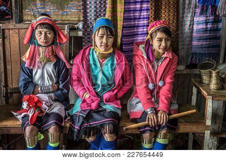 Inle Lake, Myanmar - January 26, 2016 : Three Women Of The Kayan Lahwi Tribe Wearing Traditional Met