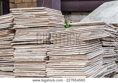 Stone Tiles Of Different Shades Are Stacked In A Large Pile. Background Image. Building Material.
