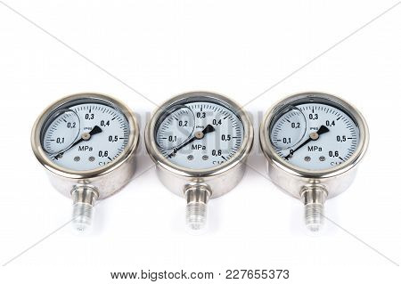 Close-up The Group Of Three New Vibration-resistant Manometer Filled With Glycerin. Manometers On Is