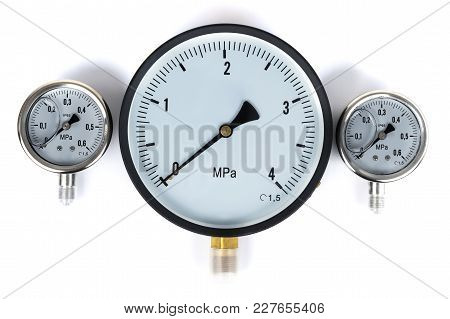 The Pressure Sensor In The Pipeline Is A Manometer. Three Gauges Of Different Sizes On A White Isola
