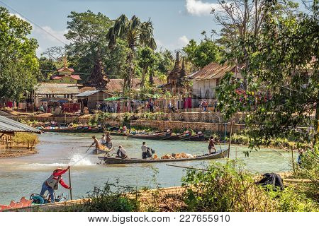 Ava, Myanmar - January 27, 2016 : Tourists And Locals Travel By Traditional Long River Boats To The