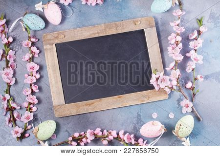 Pink Cherry Blossom Twigs Frame On Gray Background, Top View Easter Scene, Copy Space On Blackboard