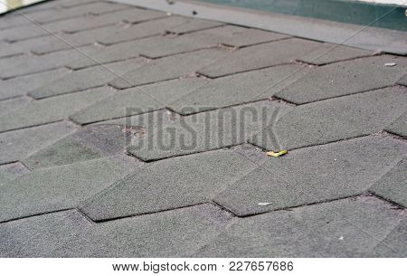 Close Up View On Dirty And Bad Asphalt Roofing Shingles Roof. Roofing Repair.
