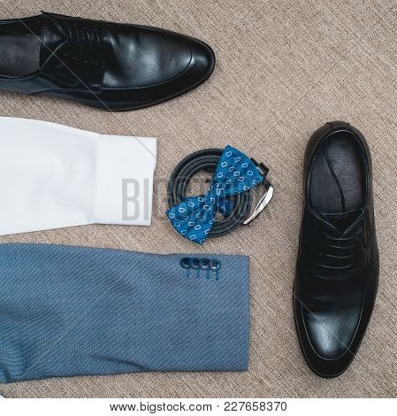 Suit, Blue Bow Tie, Leather Black Shoes And Belt. Grooms Wedding Morning. Close Up Of Modern Man Acc