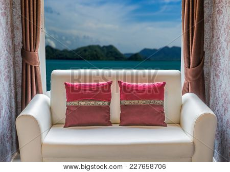 White Sofa In Living Room With Outside Window Sea View