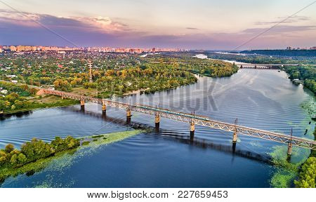 Kiev Urban Electric Train On The Petrovsky Railway Bridge Across The Dnieper In Ukraine