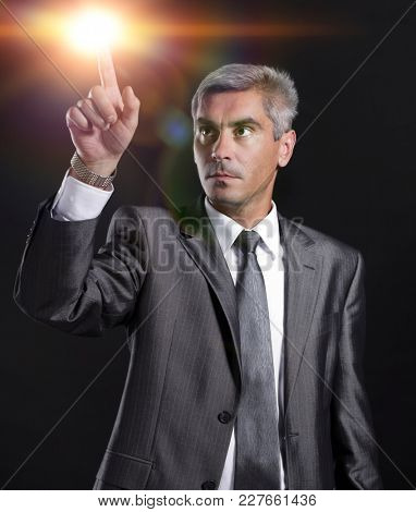 adult businessman pointing at a blank space