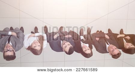 view from the top.business team looking up